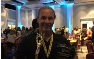 diego nieves receiving award