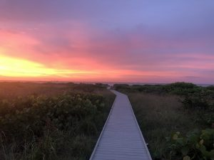 Boardwalk to the beach at sunset