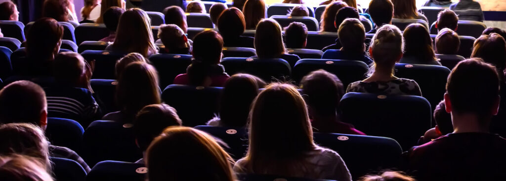 People watching a movie in the theatre