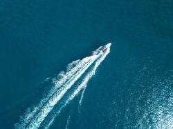 boat on water by sanibel island